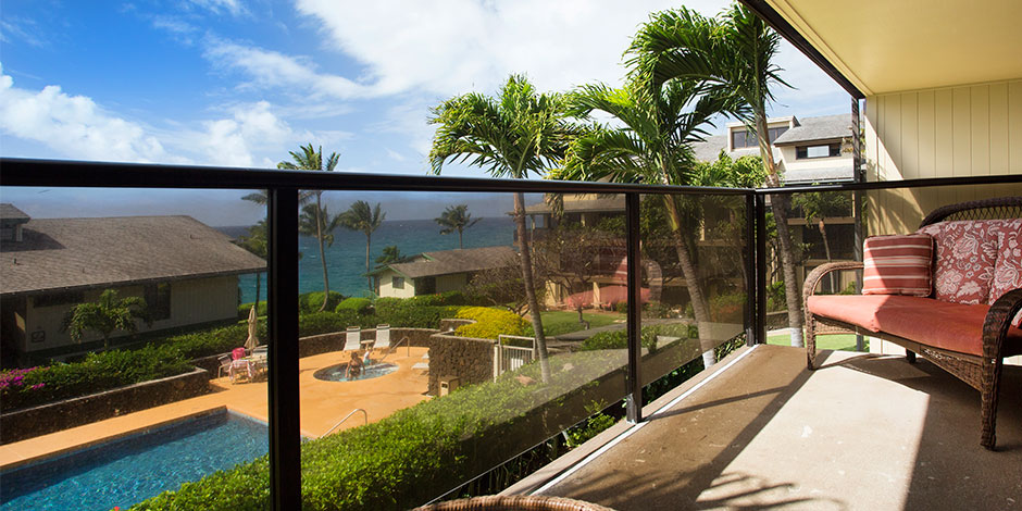 View of pool and ocean from lanai of Makahuena at Poipu