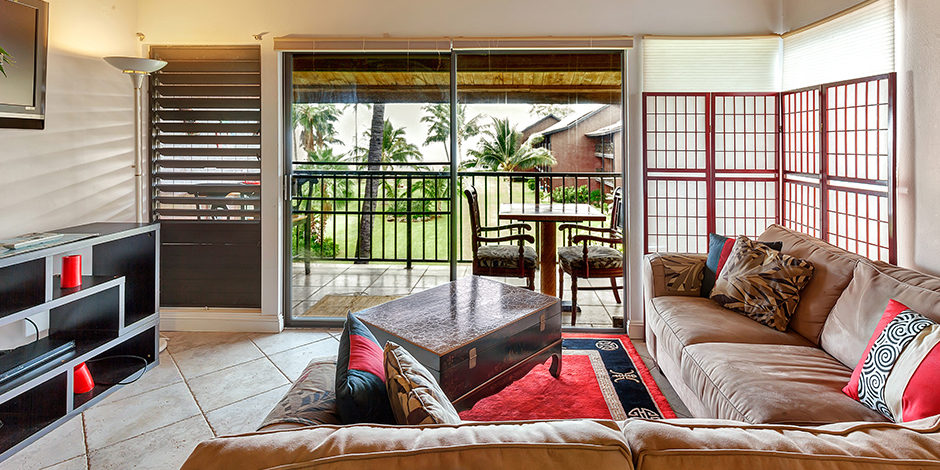 Living room area with access to Lanai in a 2-Bedroom Ocean View at Molokai Shores