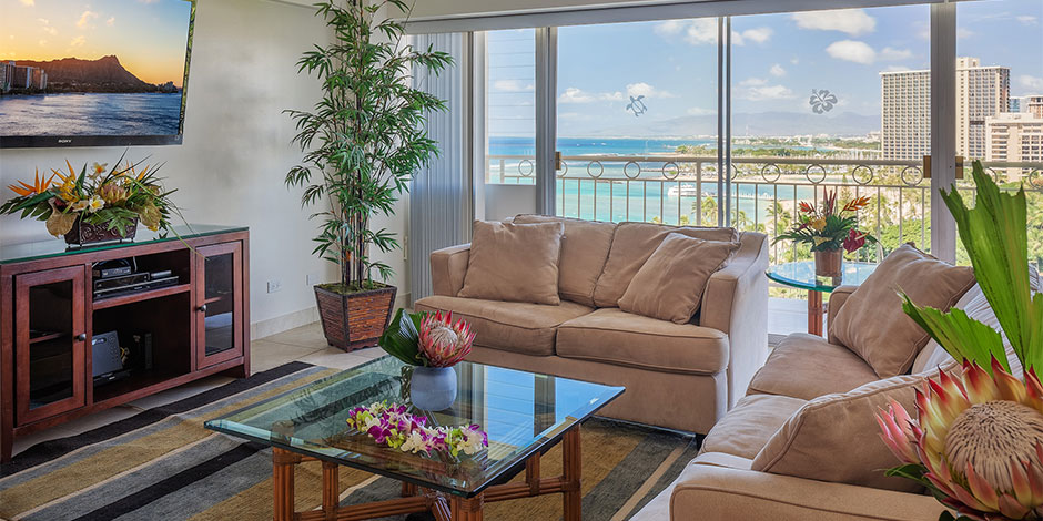 Living room for the 2 bedroom Deluxe Ocean View at Castle Waikiki Shore