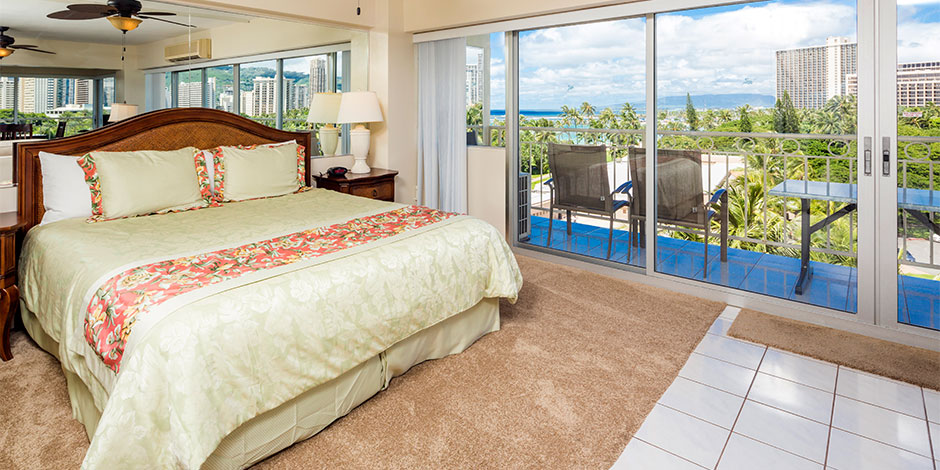 Bedroom at the 2 bedroom Deluxe Ocean View at Castle Waikiki Shore
